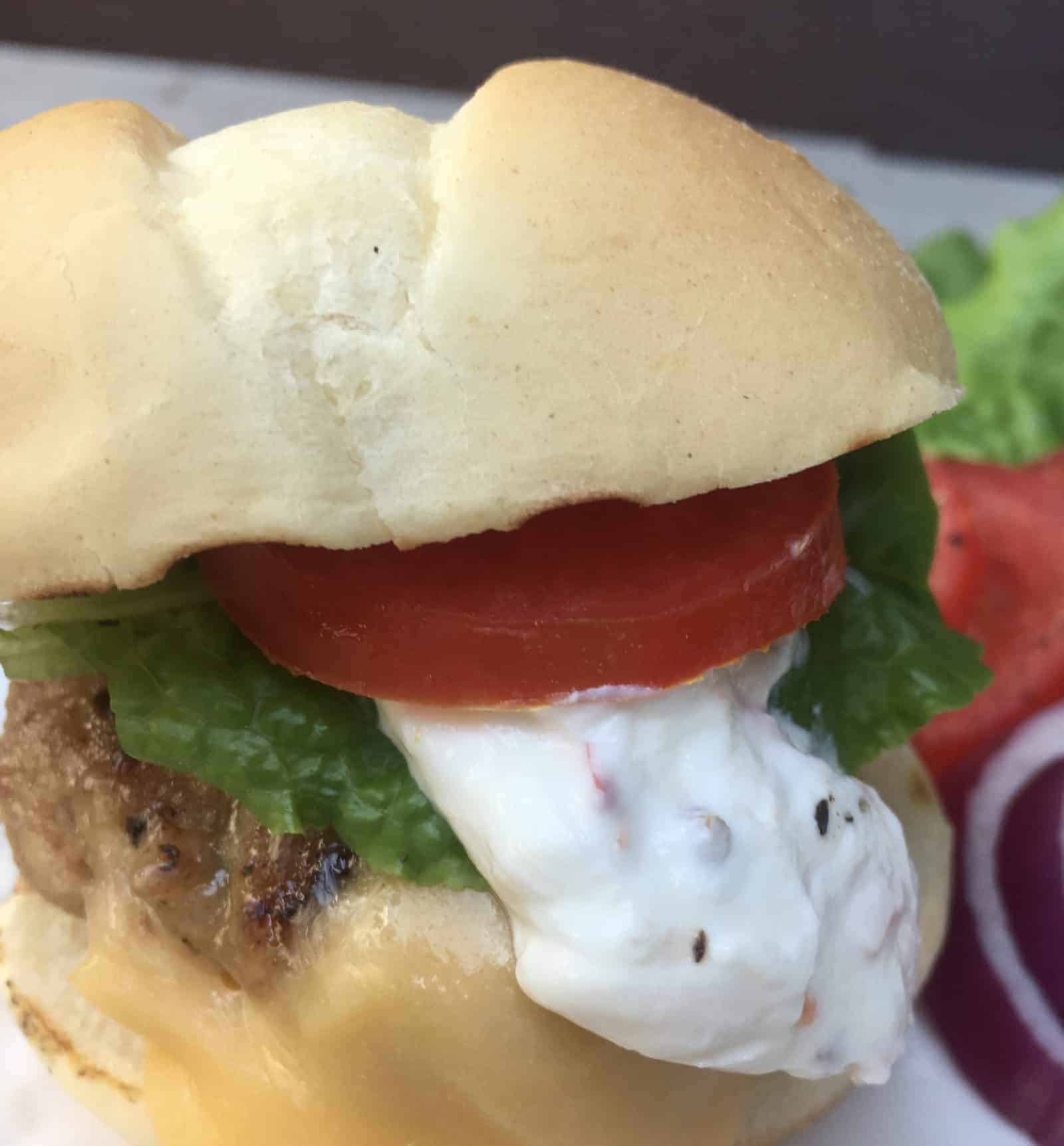 Scrumptious Turkey Slider from Gourmet Done Skinny with Jalapeno cream sliding off slider