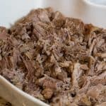 Kalua Pig shredded in white casserole dish