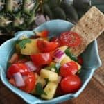Pineapple Salsa with chip in bowl