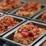 Meatloaf with ketchup and bacon crumbles in mini loaf pans