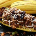 Healthy Stuffed Delicata Squash with Spicy Chicken Sausage and Cranberries from Gourmet Done Skinny