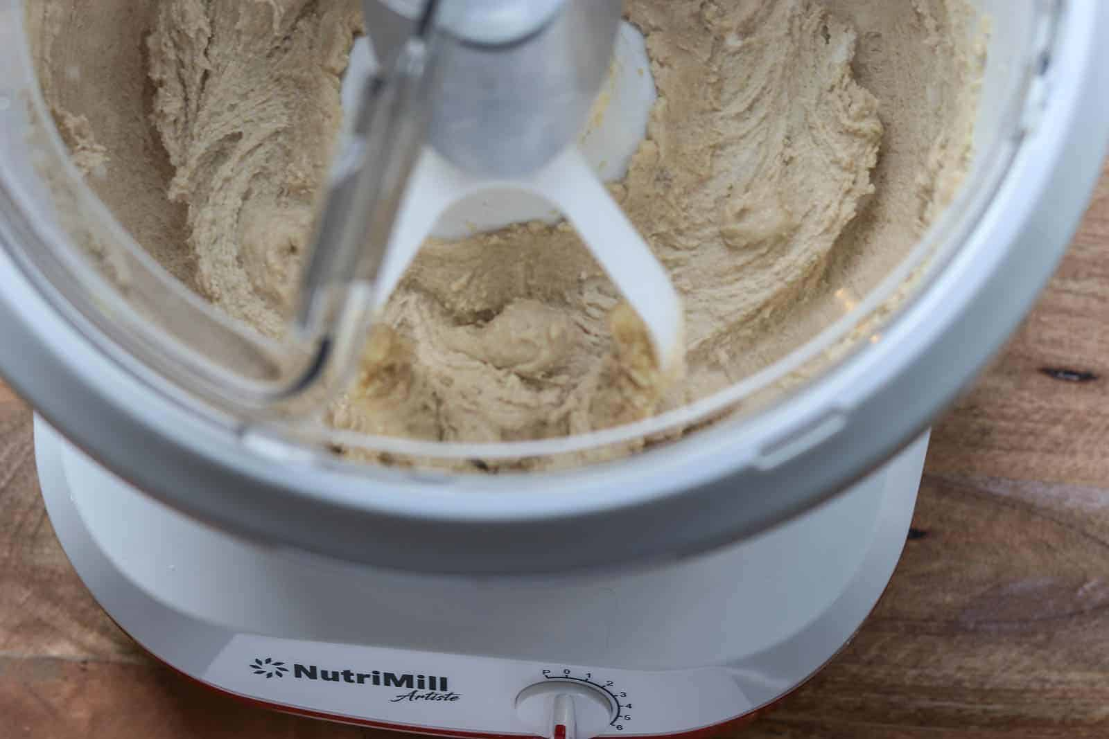 Nutrimill Artist Mixer with creamed butter, sugar and vanilla.
