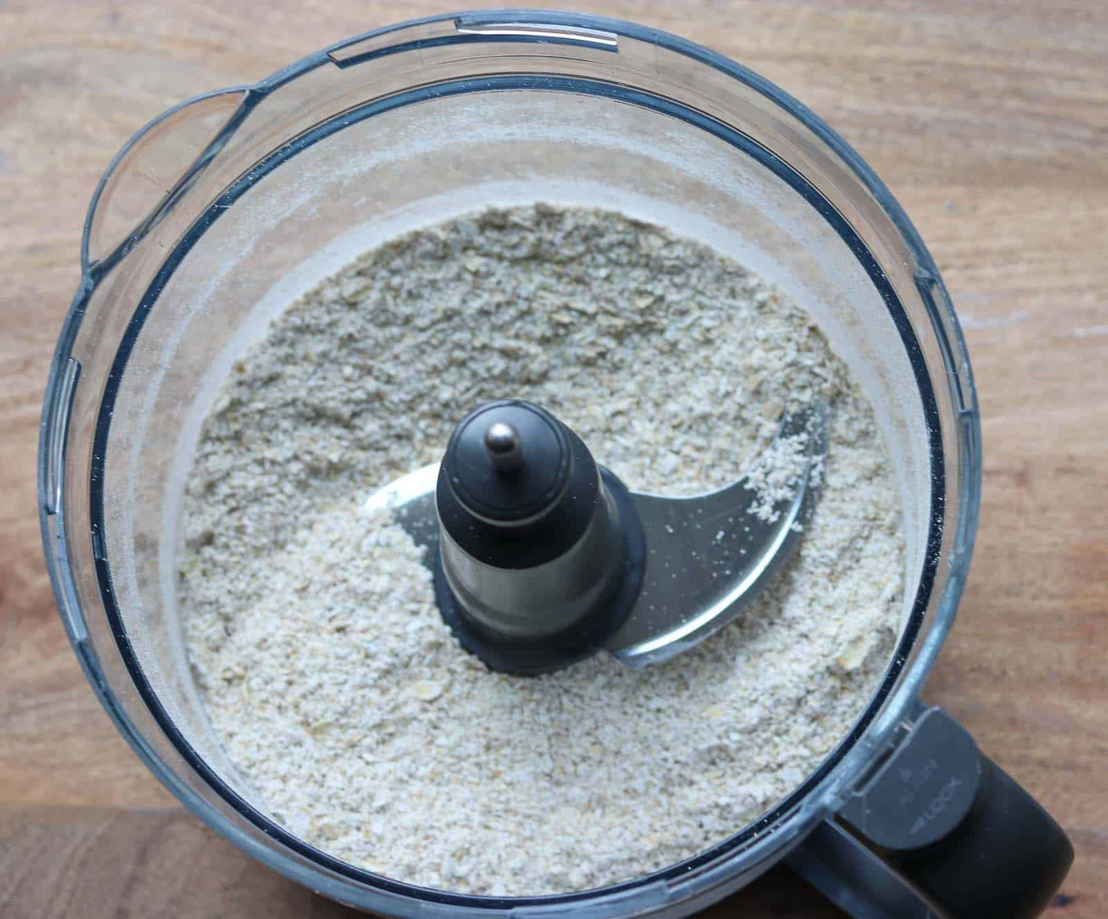 A food processor bowl with ground oatmeal from Gourmet Done Skinny