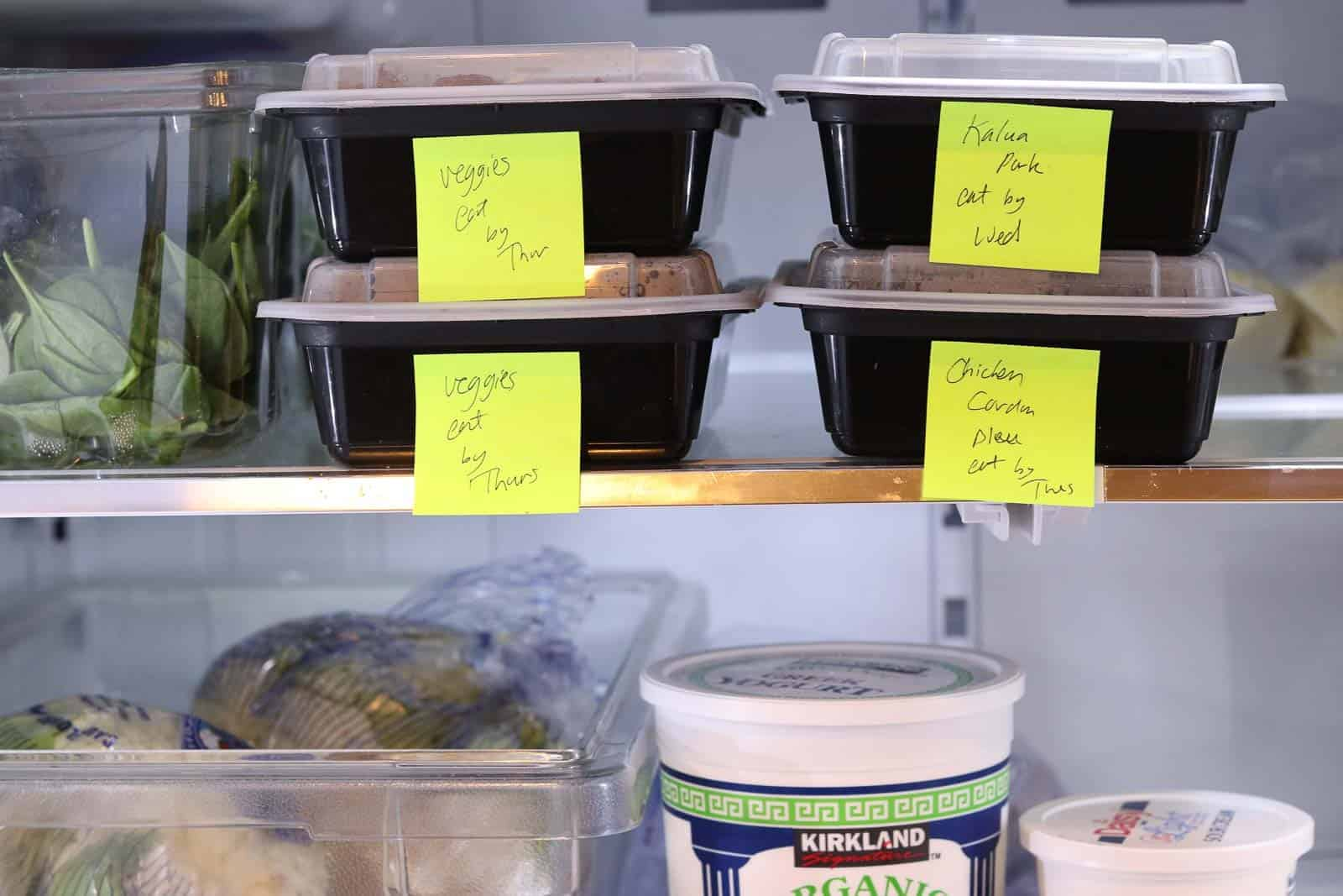 refrigerator with black boxes of food labeled veggies, pork, chicken cordon bleu, yogurt, cauliflower, sour cream from Gourmet Done Skinny