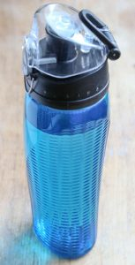 Blue water bottle with measuring guide on lid