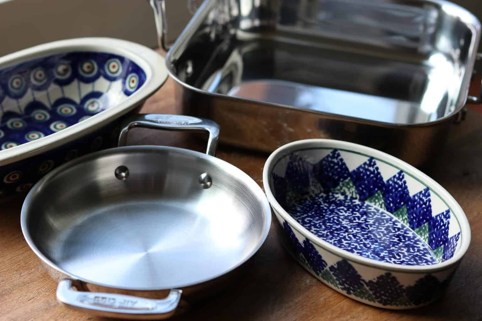A variety of pans, Polish pottery dishes on a wooden board to use to bake the dip from Gourmet Done Skinny