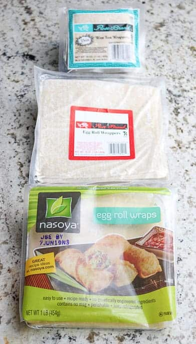 A package of Won ton wrappers on top, and 2 different packages of egg roll wrappers in the middle and on bottom of picture from Gourmet Done Skinny