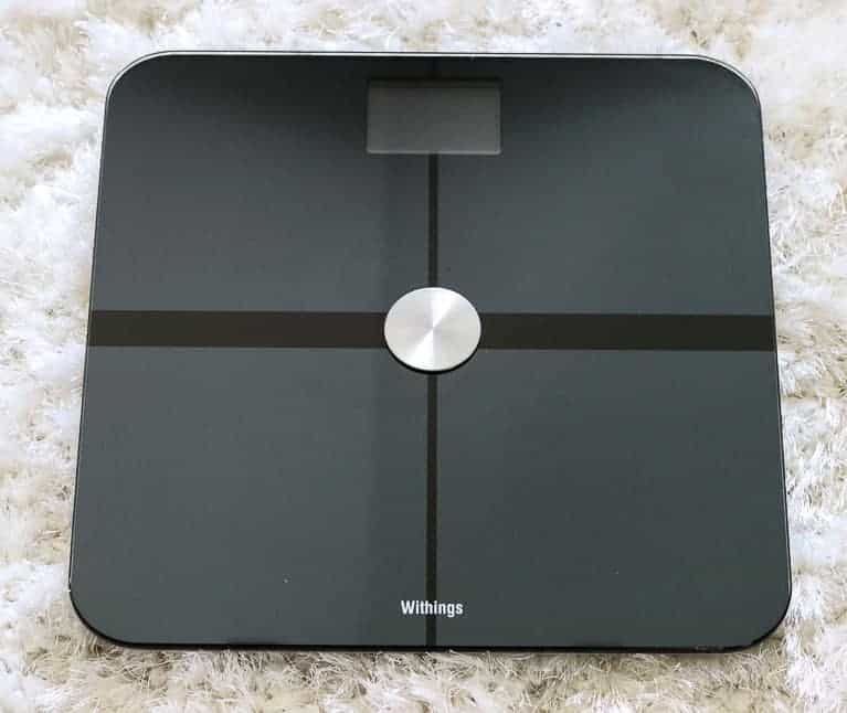 Withings Scale on a white rug from Gourmet Done Skinny