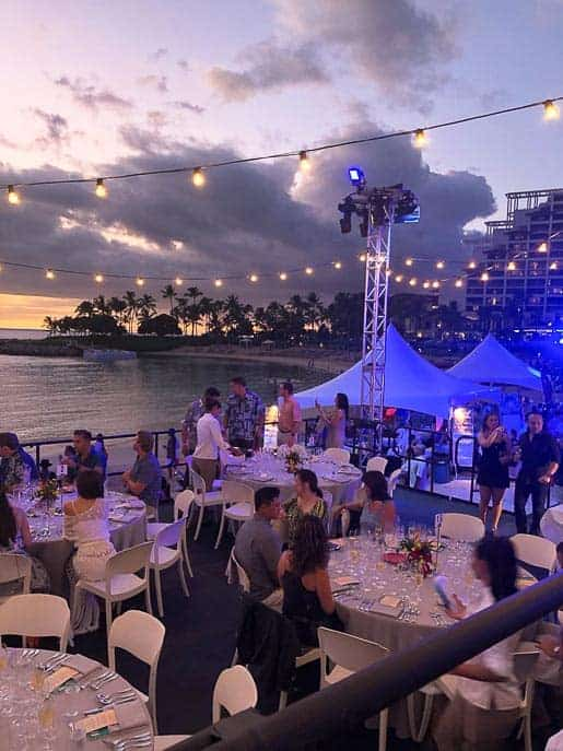 Hawaiian Food and Wine festival-tables, tents, people on the beach from Gourmet Done Skinny