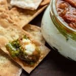 Crackers with tomato bacon jam and ricotta and a ricotta jam jar