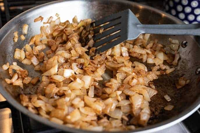 Caramelized onions in a pan with a spatula