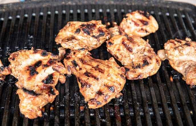 chicken thighs on a grill